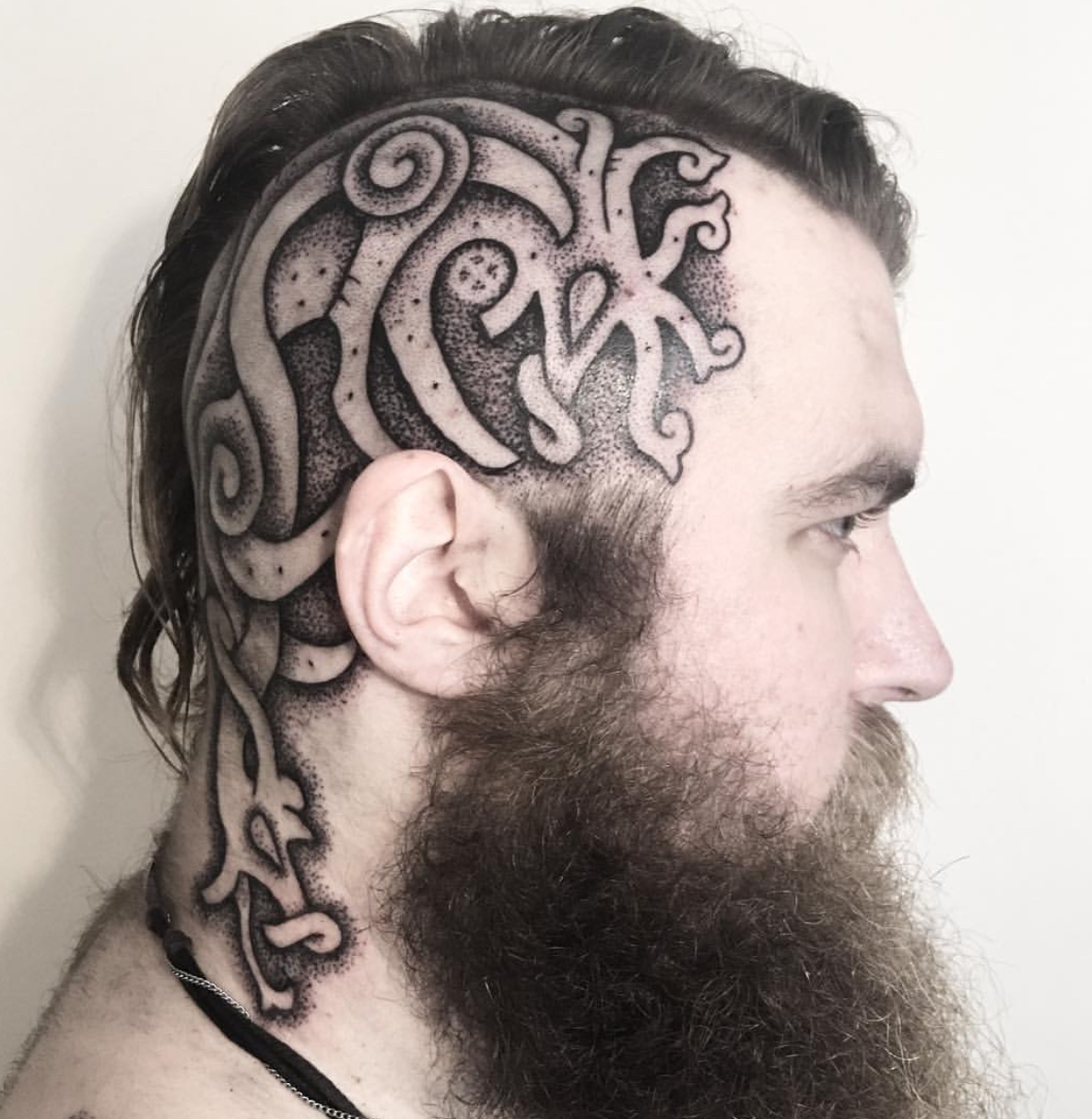 Viking head tattoo sun wheel knotwork